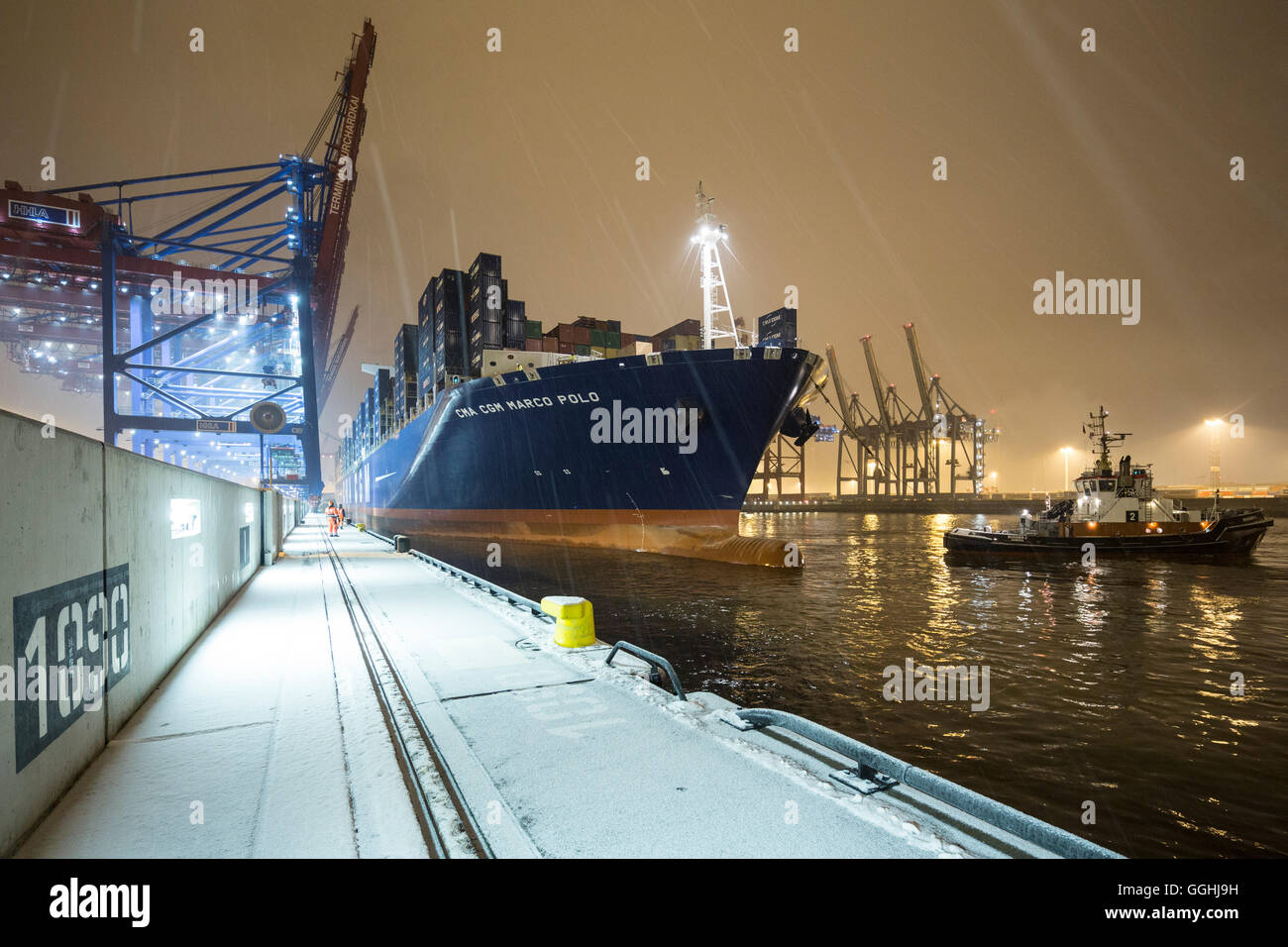Docking maneuver of the CMA CGM Marco Polo in the Container Terminal Burchardkai in Hamburg, Germany - Stock Image