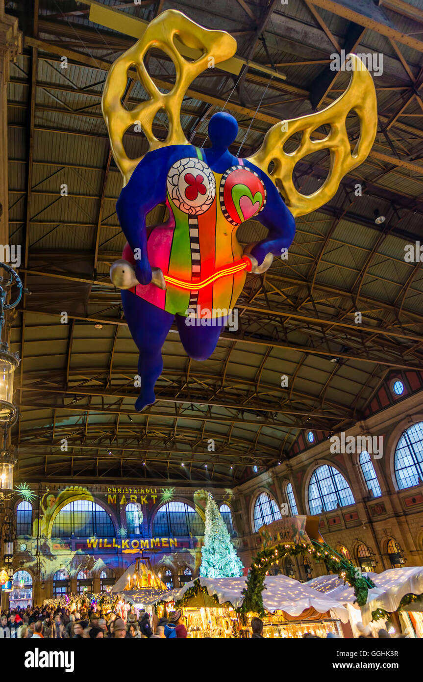 Guardian Angel by Niki de St. Phalle in the Main Station, Christmas Market, Zurich, Switzerland - Stock Image
