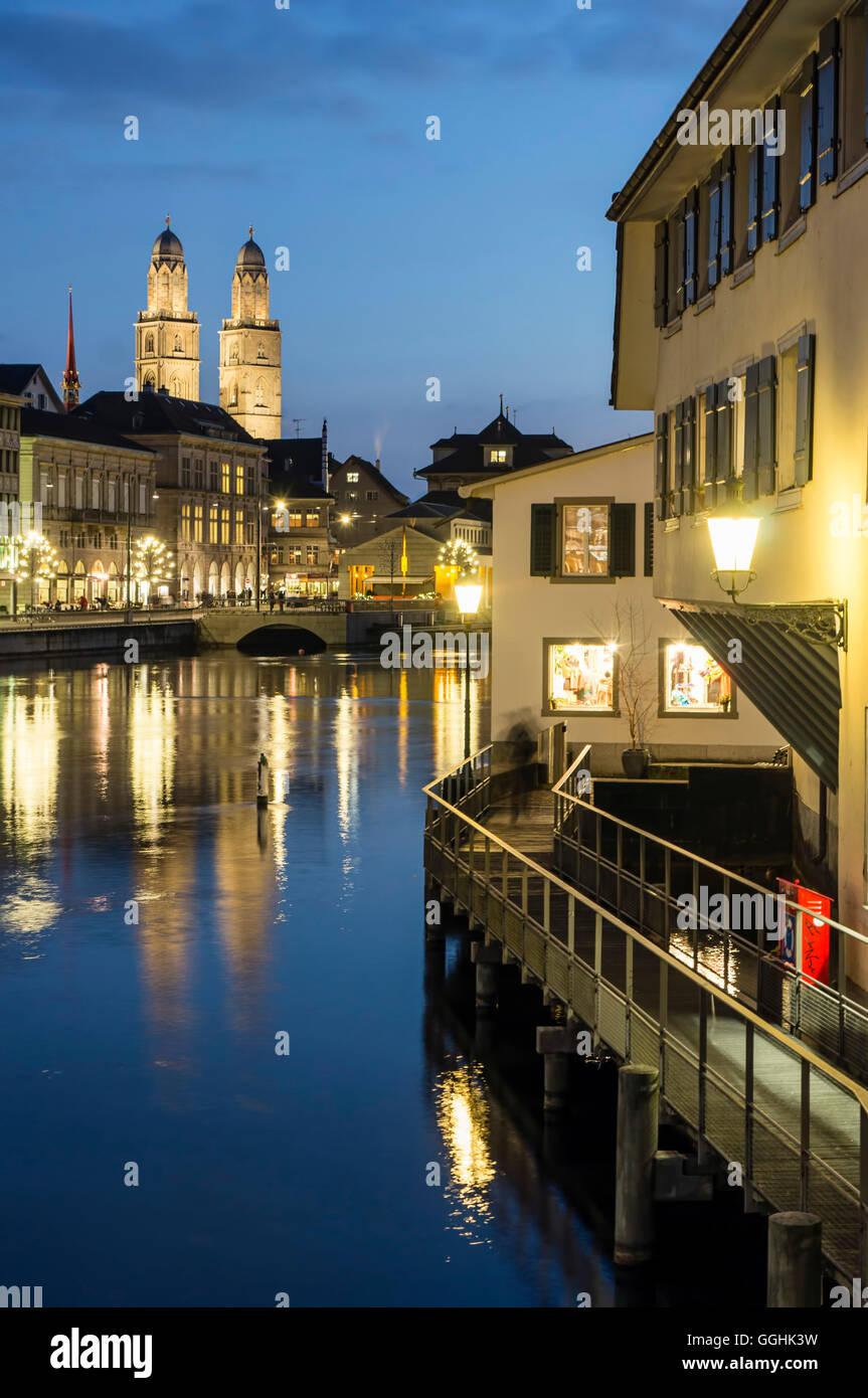 River Limmat and Grossmunster at dusk, Zurich, Switzerland - Stock Image