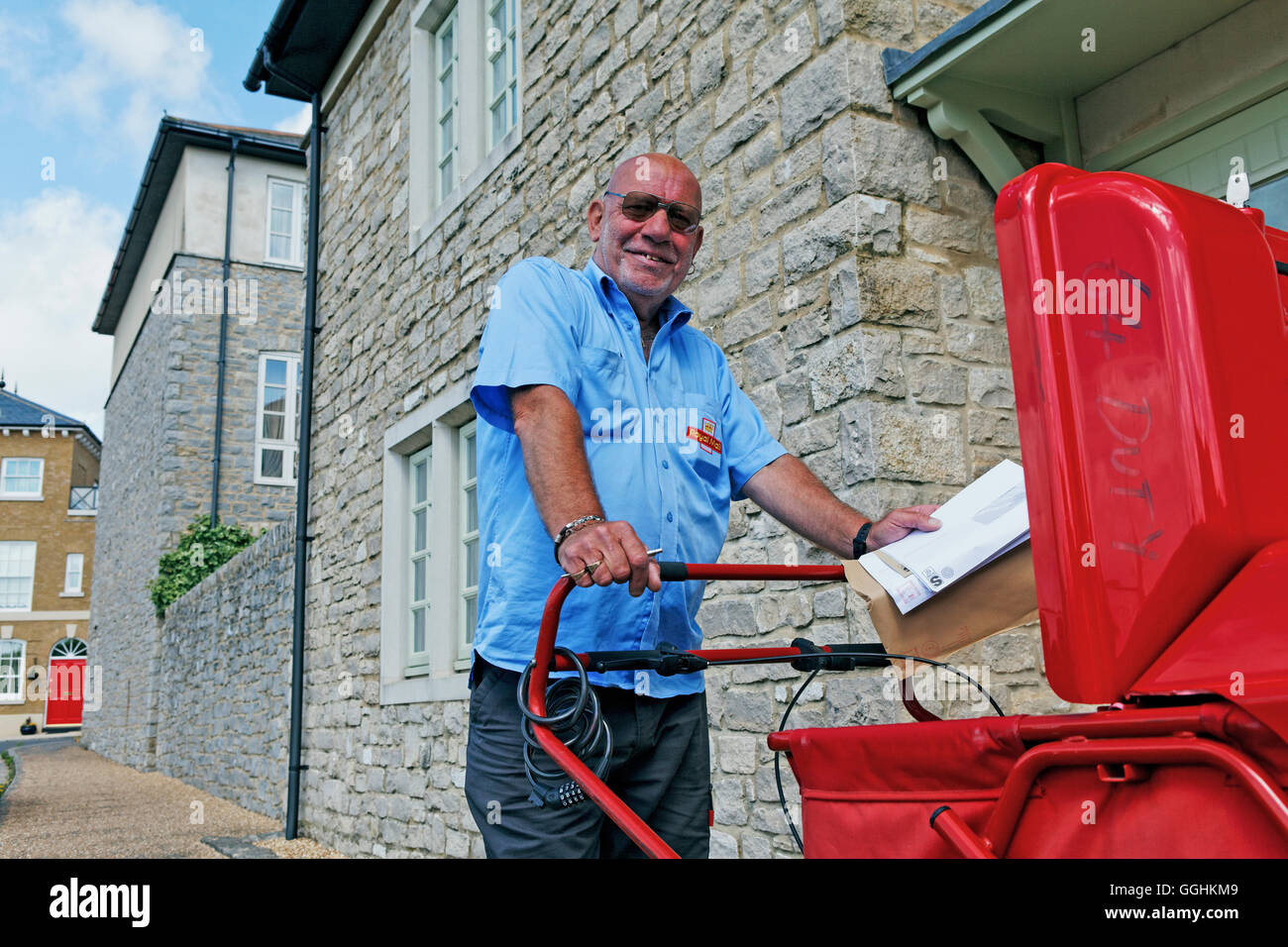 Postman in Poundbury, Dorchester, Dorset, England, Great Britain - Stock Image