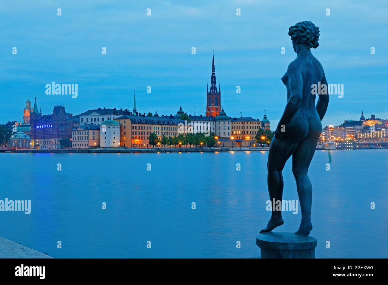 Bronze statue of Dansen in the city hall gardens and Riddarholmen with Riddarholmen church in the background, Stockholm, Stock Photo