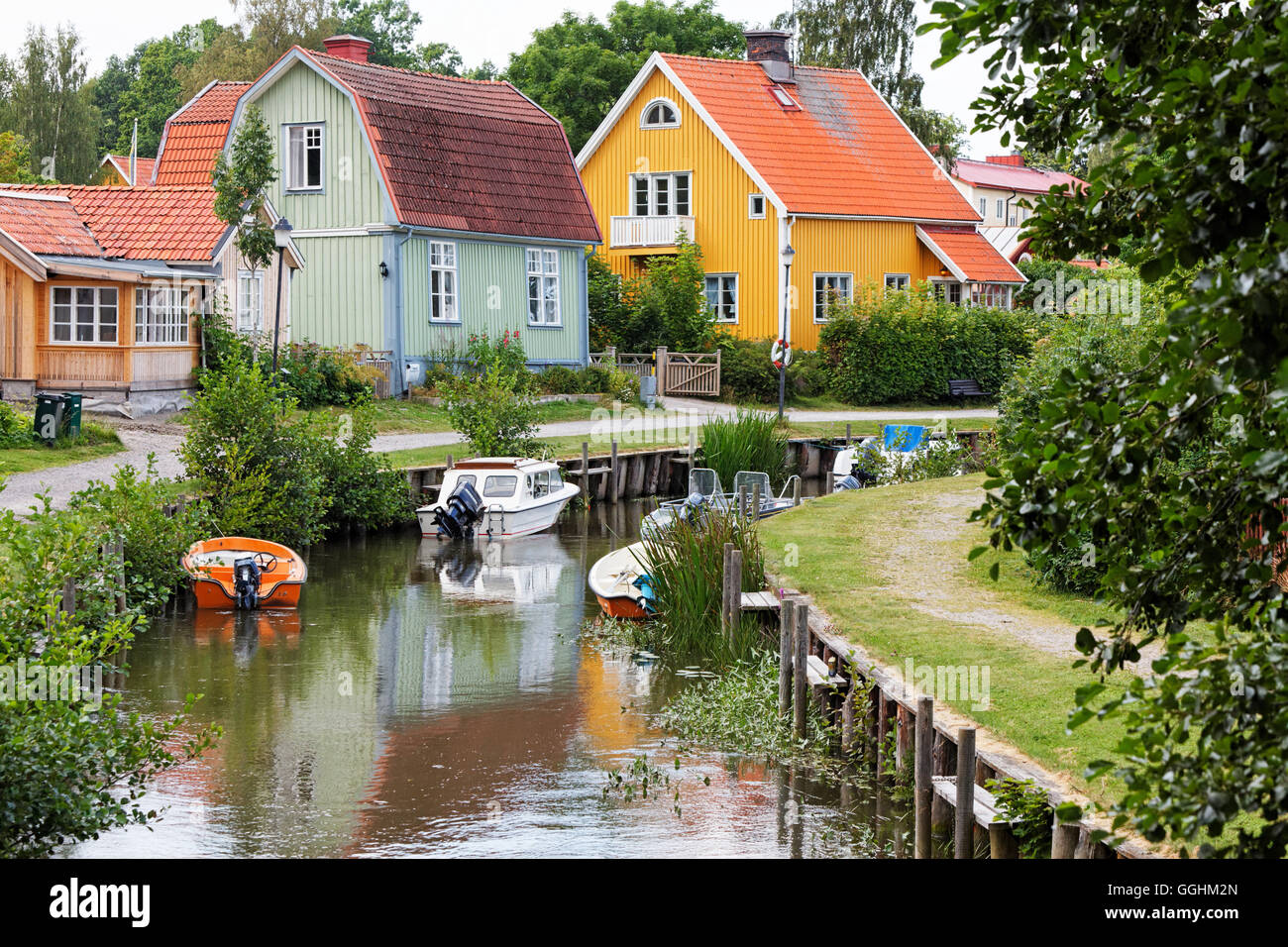 Canal with typical wooden houses, Trosa, Sweden - Stock Image
