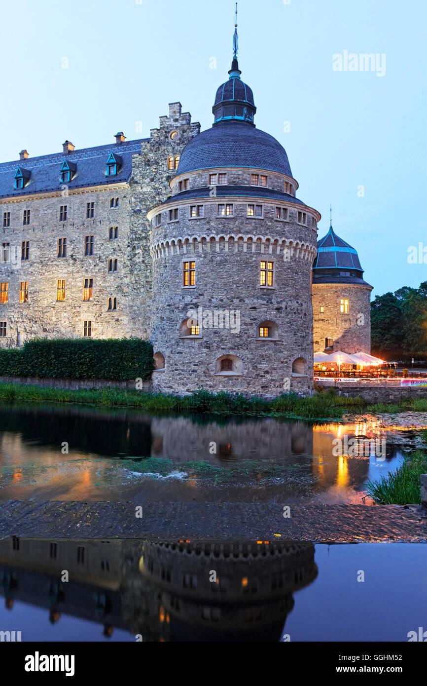 Moated castle in the evening, Oerebro slott, Oerebro, Sweden - Stock Image