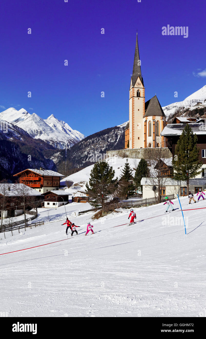 Children learning to ski, Heiligenblut and Grossglockner, National Park Hohe Tauern, Carinthia, Austria, Europe - Stock Image