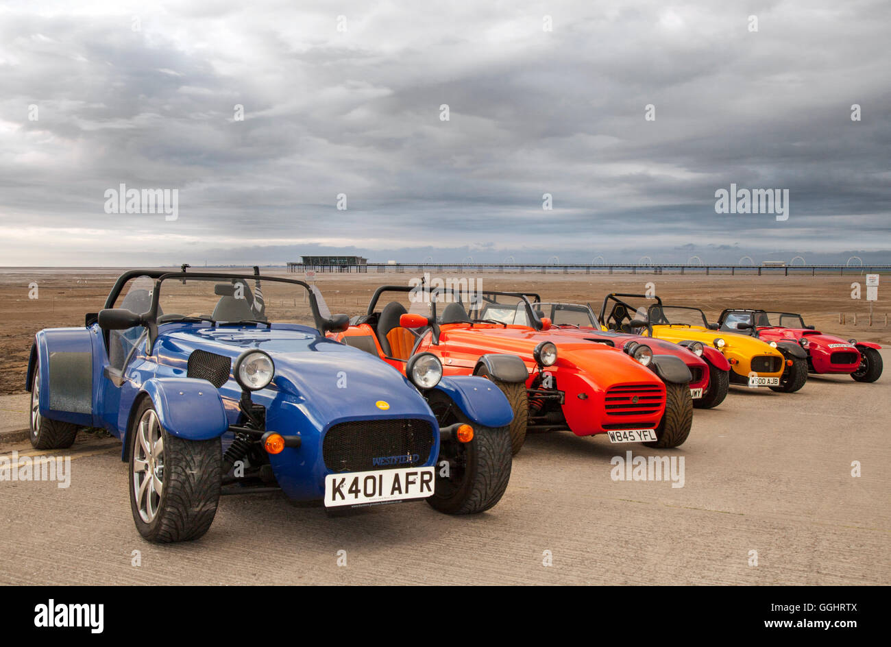 2007 Westfield Se1, several two-seater, open top sportscars, as classic car club meet on Southport beach on a slipway - Stock Image