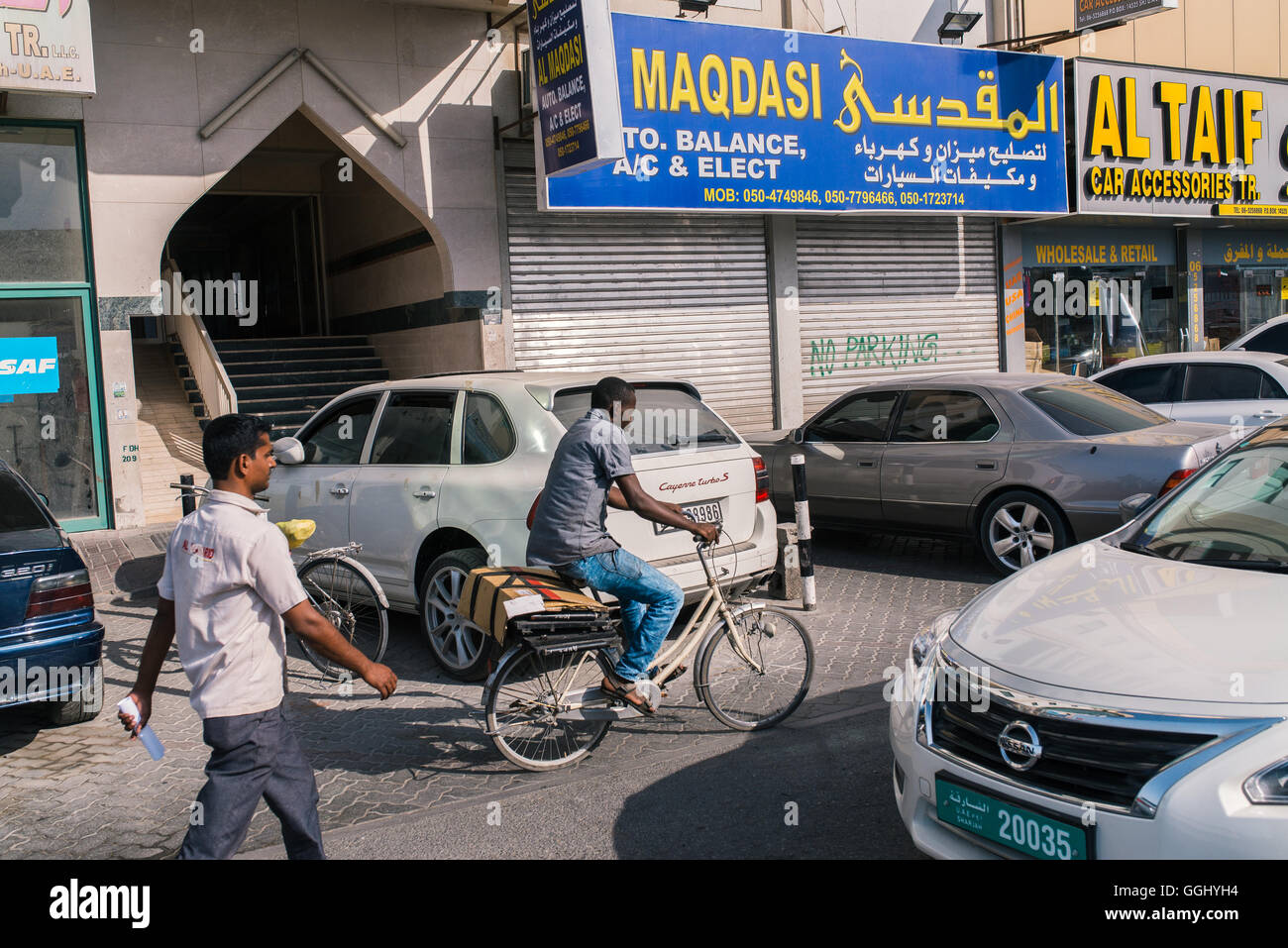 Sharjah, UAE  A man rode his bike down a street lined with