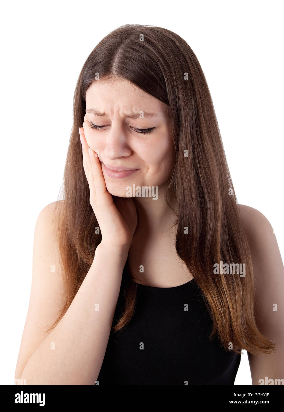 teenage girl with toothache on white background - Stock Image