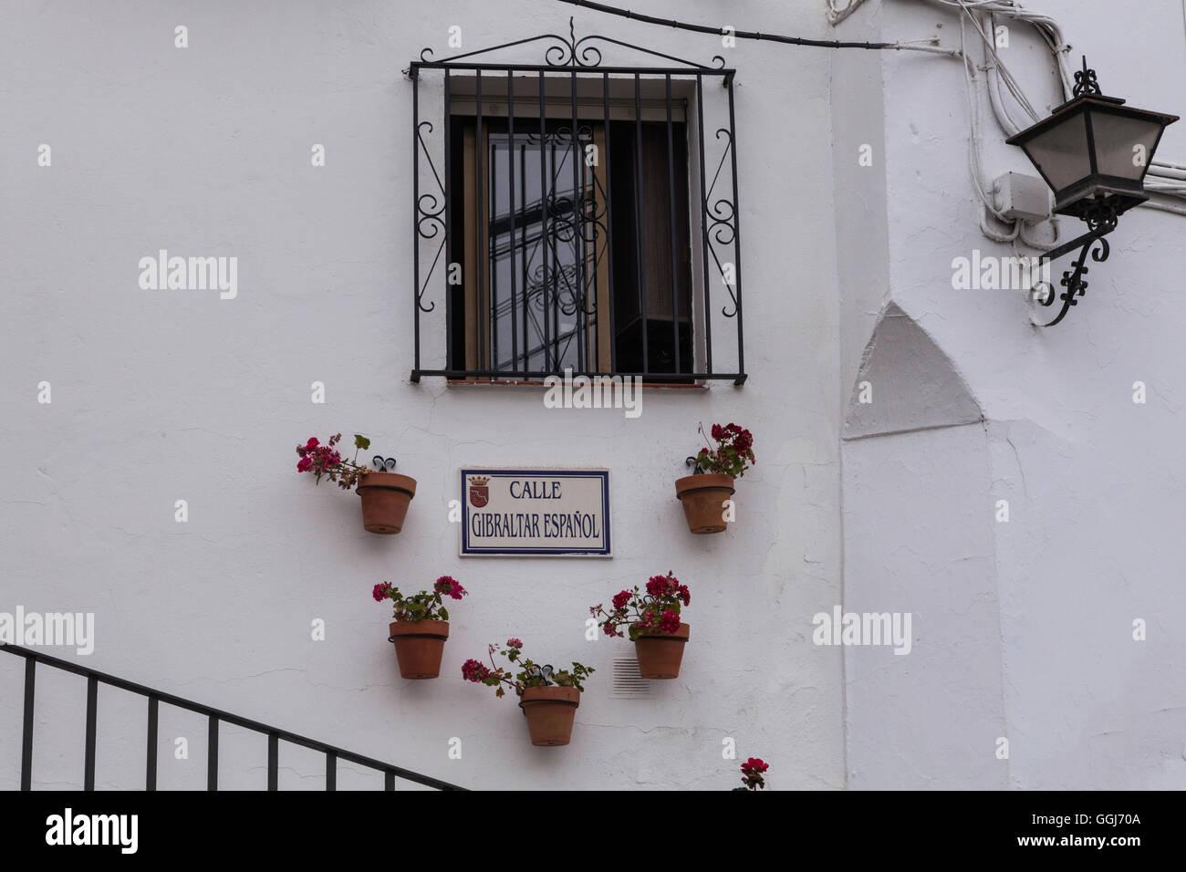 A house showing a street sign i Sahara de la Sierra. - Stock Image