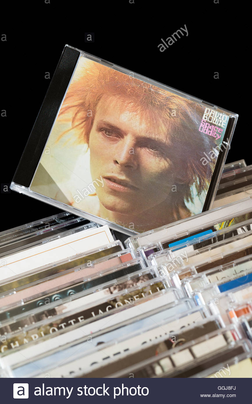Space Oddity, 1969 David Bowie CD pulled out from among rows of other CD's - Stock Image