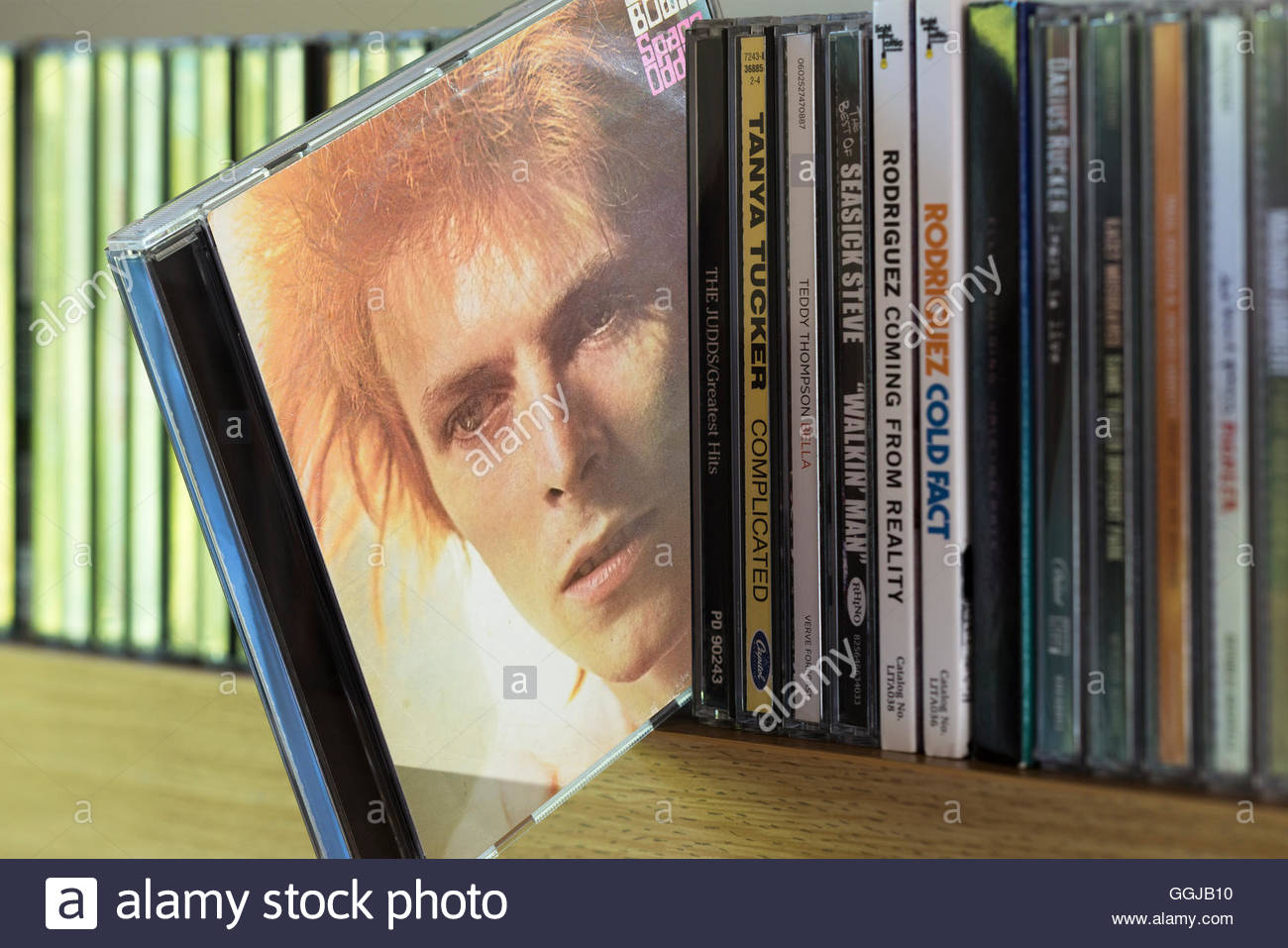 Space Oddity, 1969 David Bowie CD pulled out from among other CD's on a shelf - Stock Image
