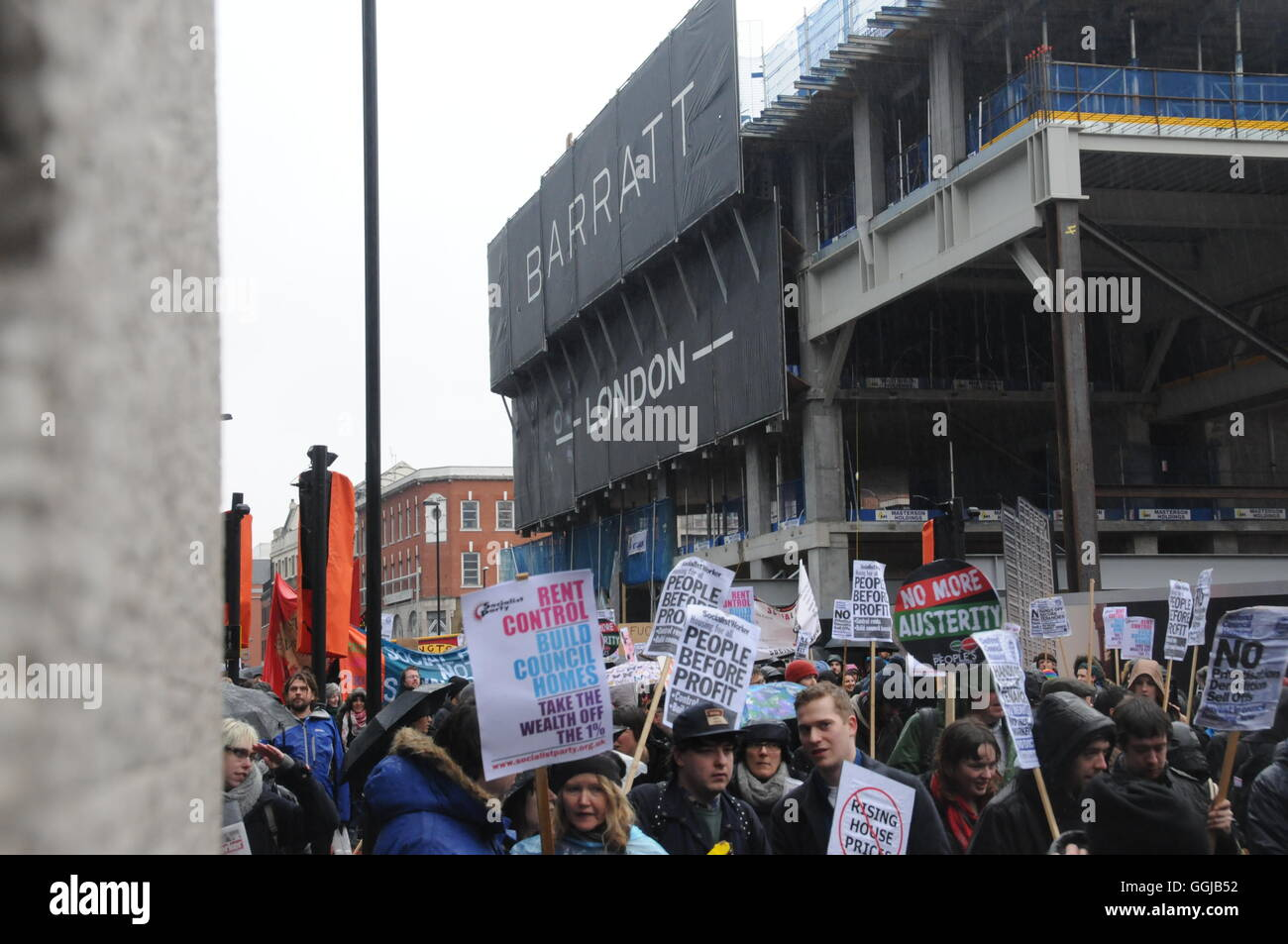 The March to London's City Hall, in protest at the lack of affordable rented housing for London's workers. - Stock Image
