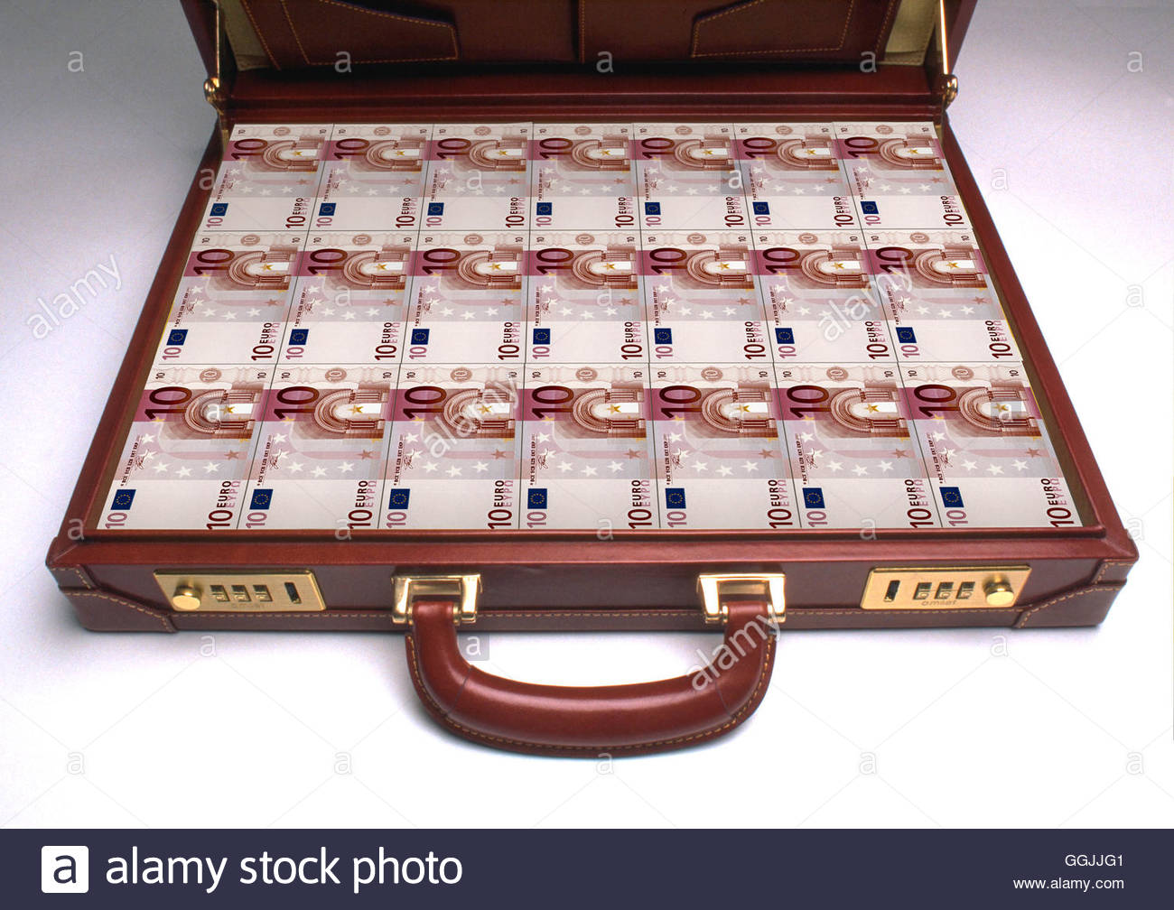Briefcase packed full of 10 euro banknotes. - Stock Image