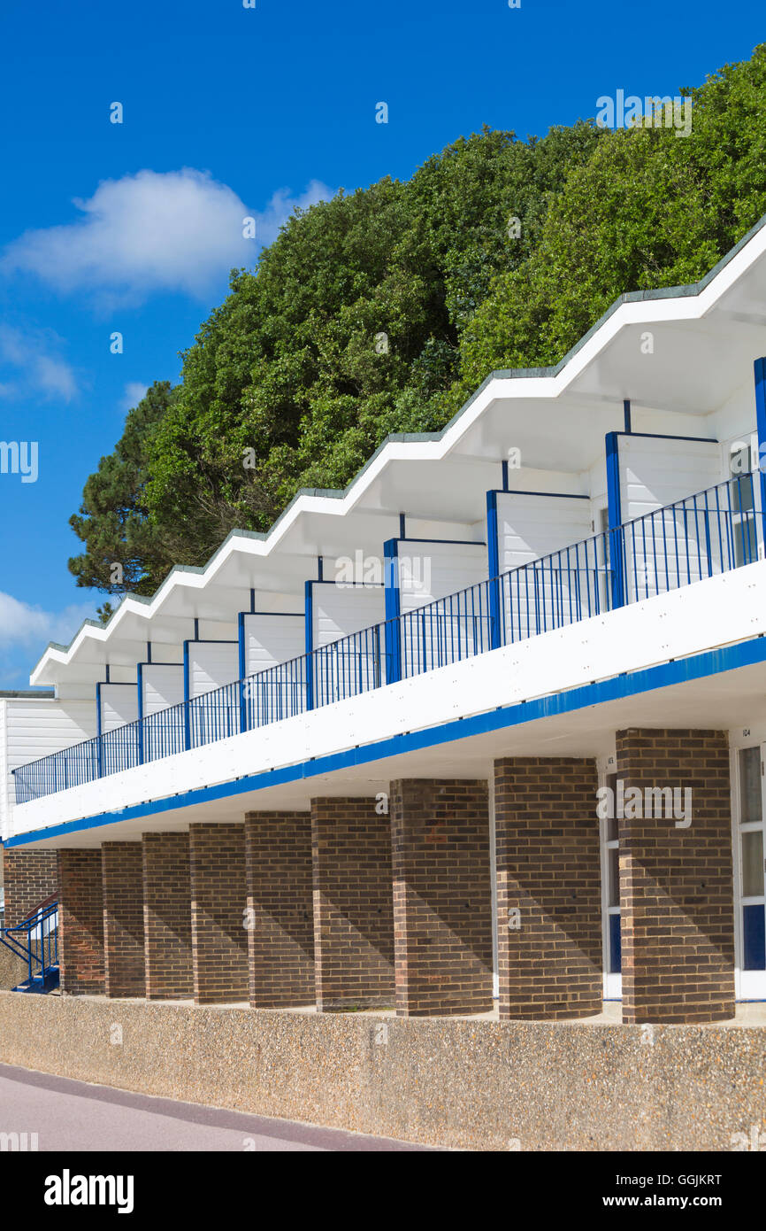 beach huts at Branksome Dene Chine, Poole in July Stock Photo