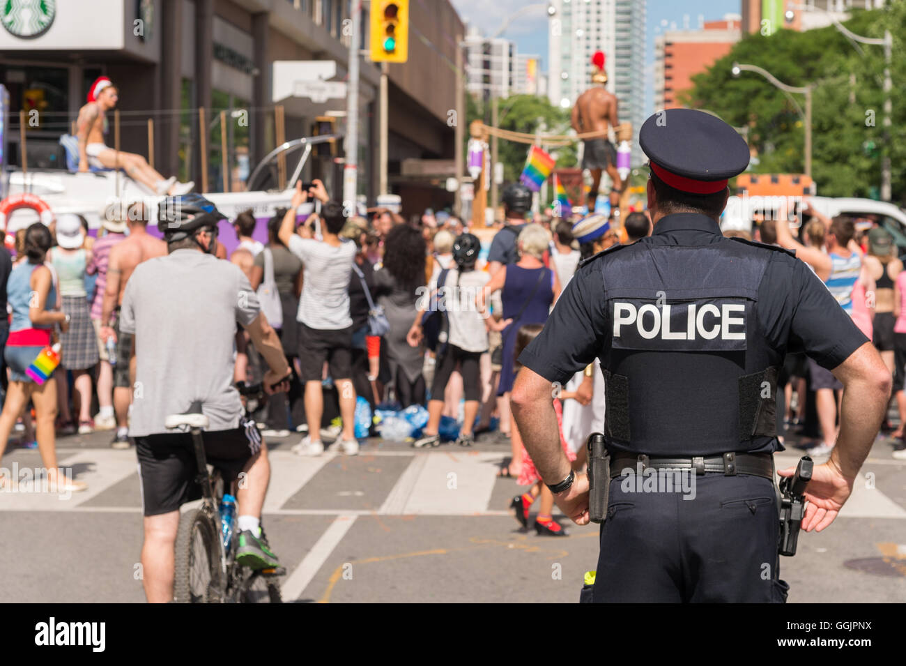 Toronto, CA - 3 July 2016: A policeman is watching the gay pride parade in Toronto, Canada. - Stock Image