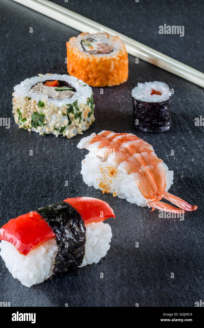 Sushi Maki Roll assortment chop sticks - Stock Image