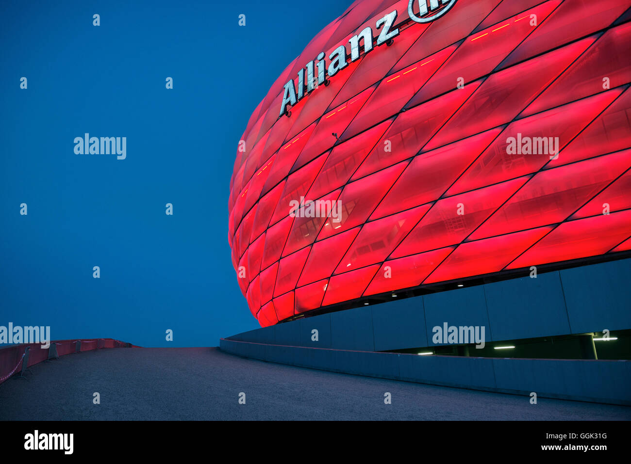 Allianz Arena at night, red light, football stadium of FC Bayern München, Munich, Bavaria, Germany, Architects - Stock Image