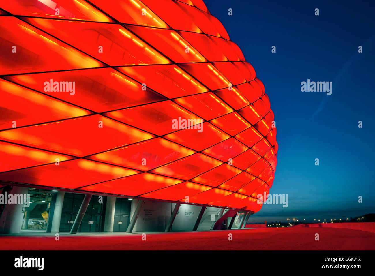 Allianz Arena at night with red light, football stadium of FC Bayern München, Munich, Bavaria, Germany, Architects - Stock Image