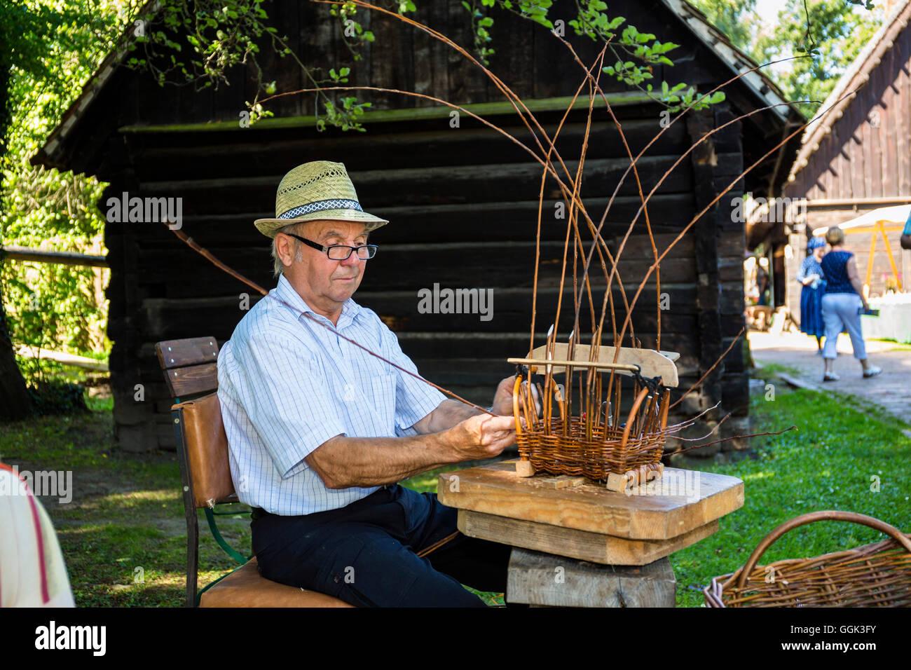 Basket maker in the Open Air Museum Lehde, Spreewald, UNESCO biosphere reserve, Lübbenau, Brandenburg, Germany, - Stock Image