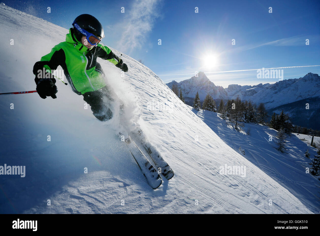 Boy downhill skiing from mount Helm (Monte Elmo), Sexten, South Tyrol, Italy - Stock Image