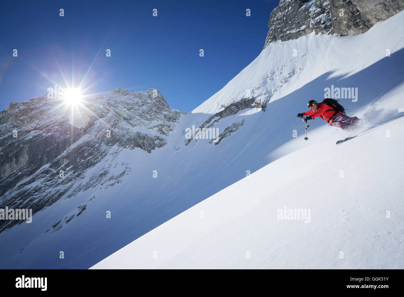 Man downhill skiing from Zugspitze, Upper Bavaria, Germany - Stock Image