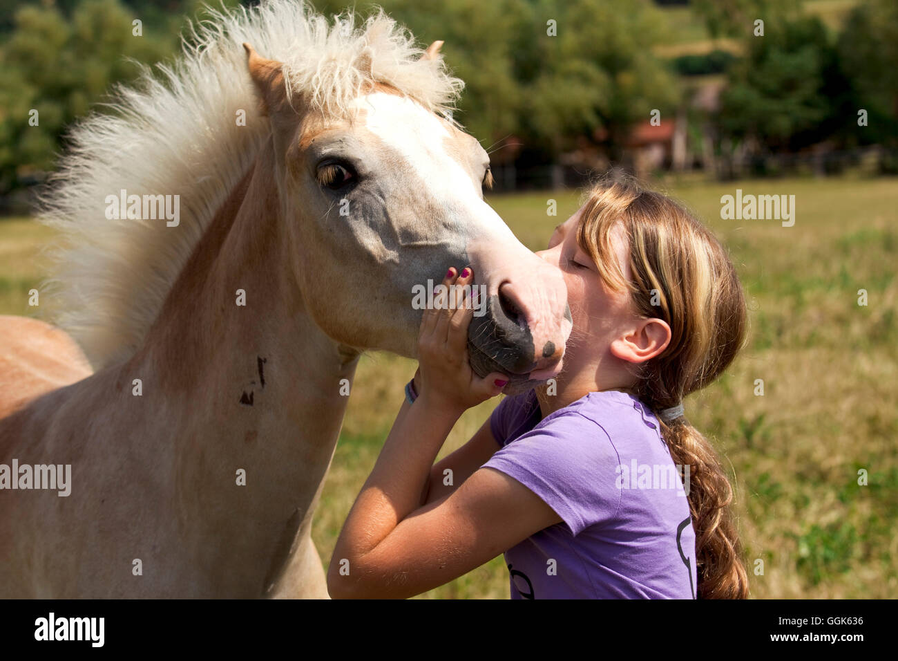 Young girl giving a young foul a kiss, Wellen, Hesse, Germany, Europe - Stock Image
