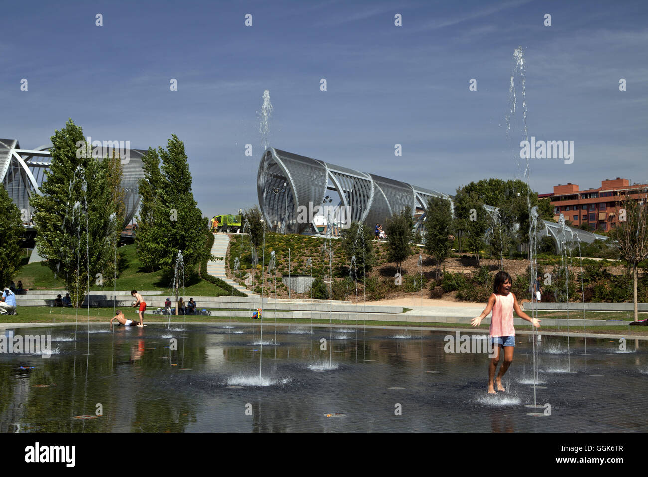 Water fountains in a park on the Rio Manzanares, Madrid, Spain Stock Photo