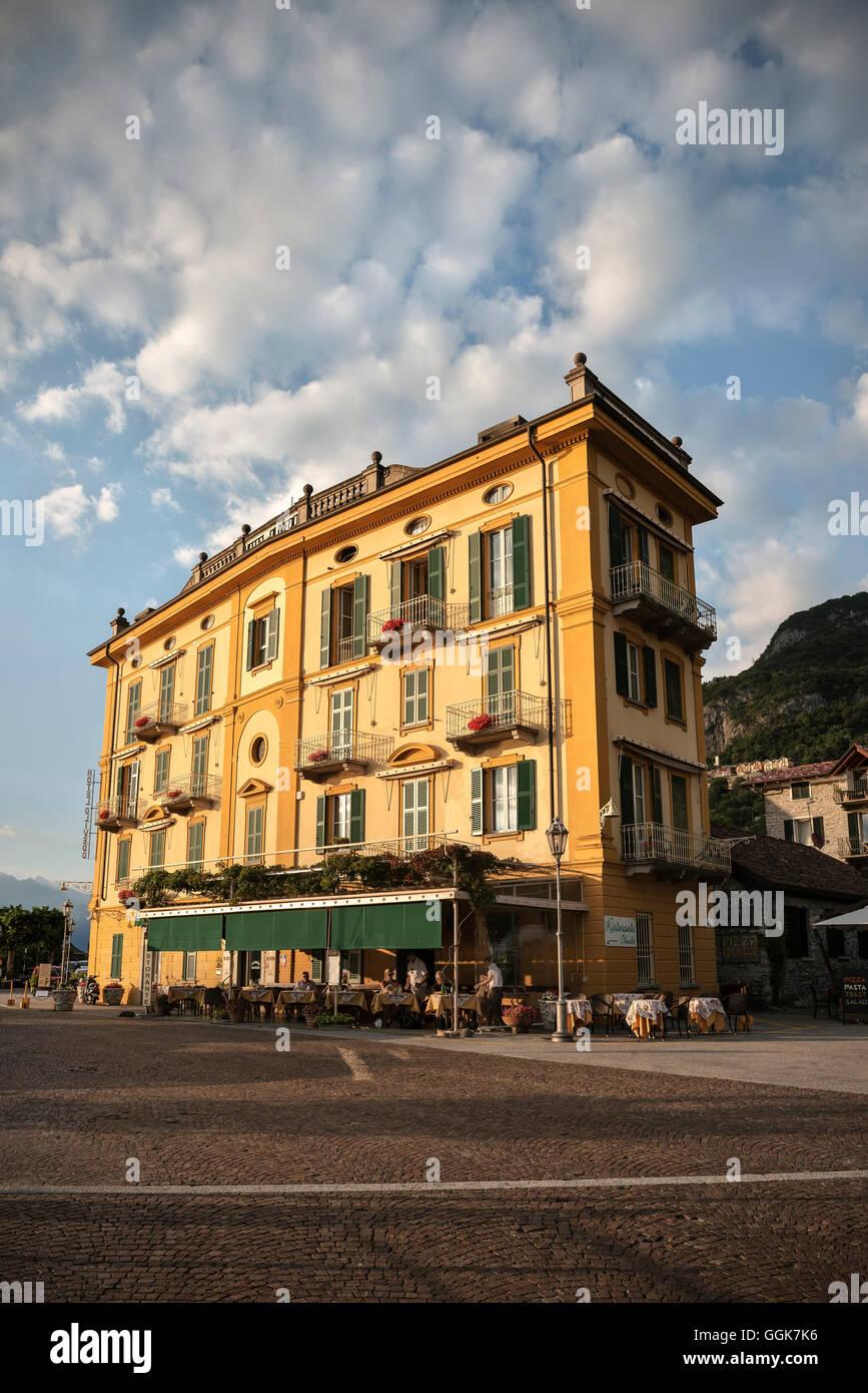 Yellow historic hotel in Varenna, Lake Como, Lombardy, Italy, Europe - Stock Image