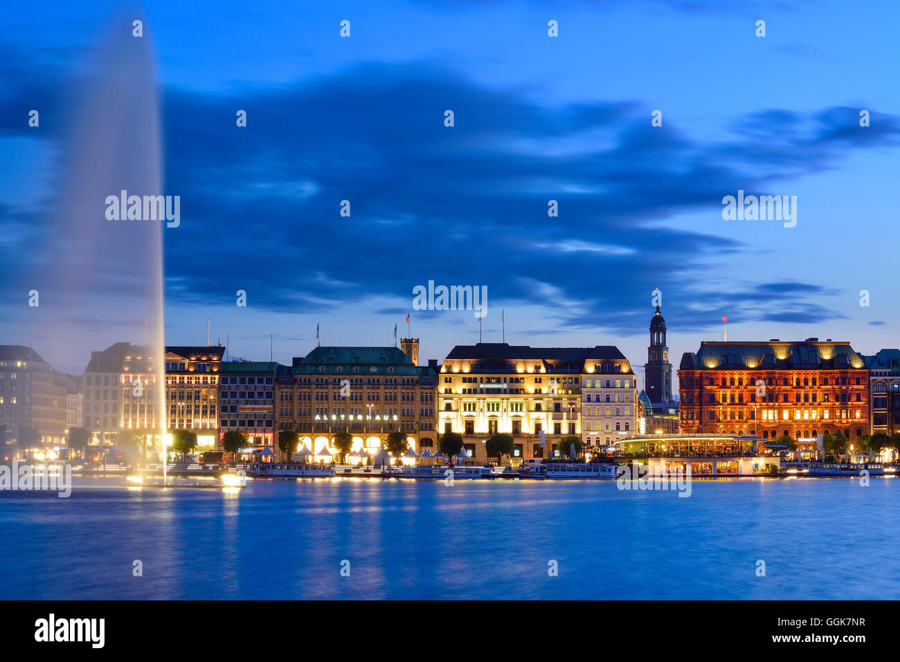 Binnenalster at night with fountain and illuminated church St. Michaelis, Binnenalster, Hamburg, Germany - Stock Image