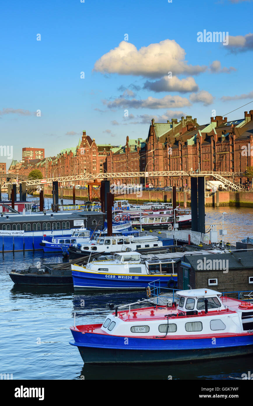 Ships in inland port with old and modern buildings of the old Warehouse district, Warehouse district, Speicherstadt, - Stock Image