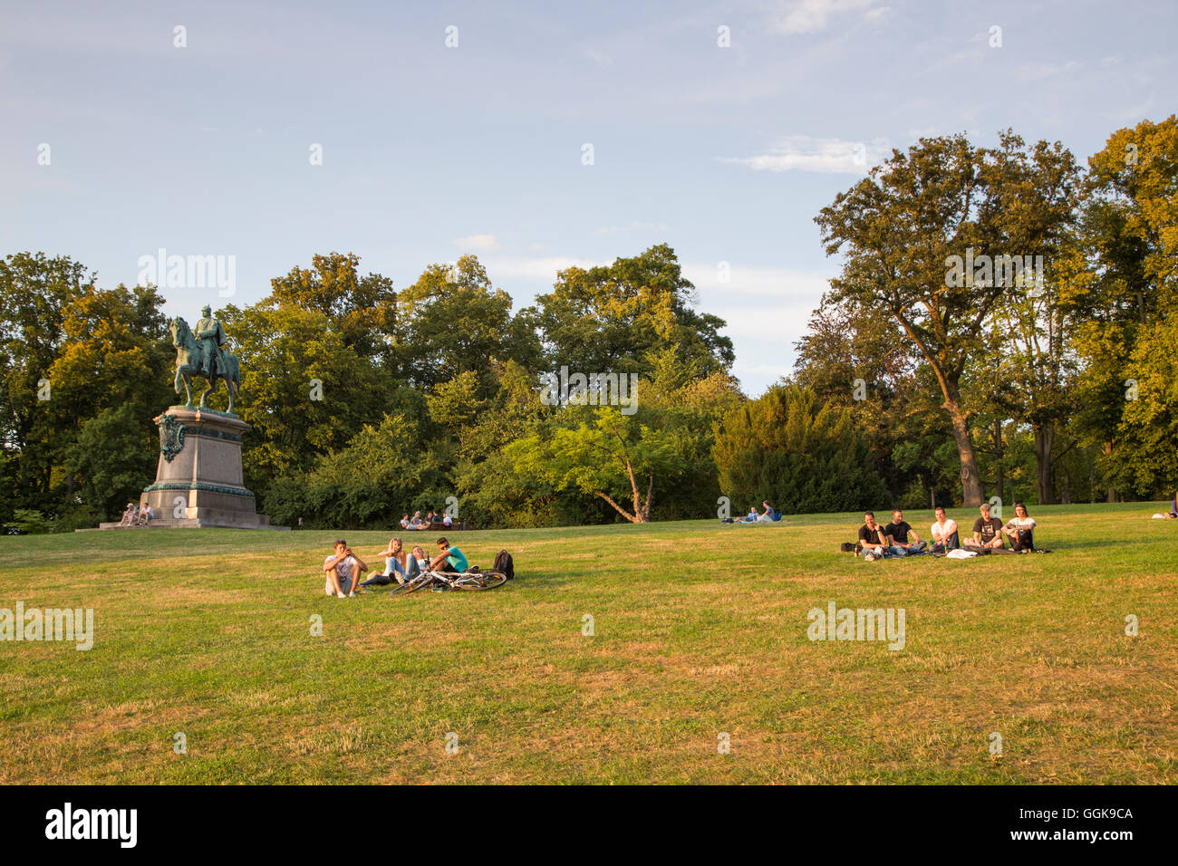 People relaxing on the lawn in Hofgarten Garden, Coburg, Franconia, Bavaria, Germany - Stock Image