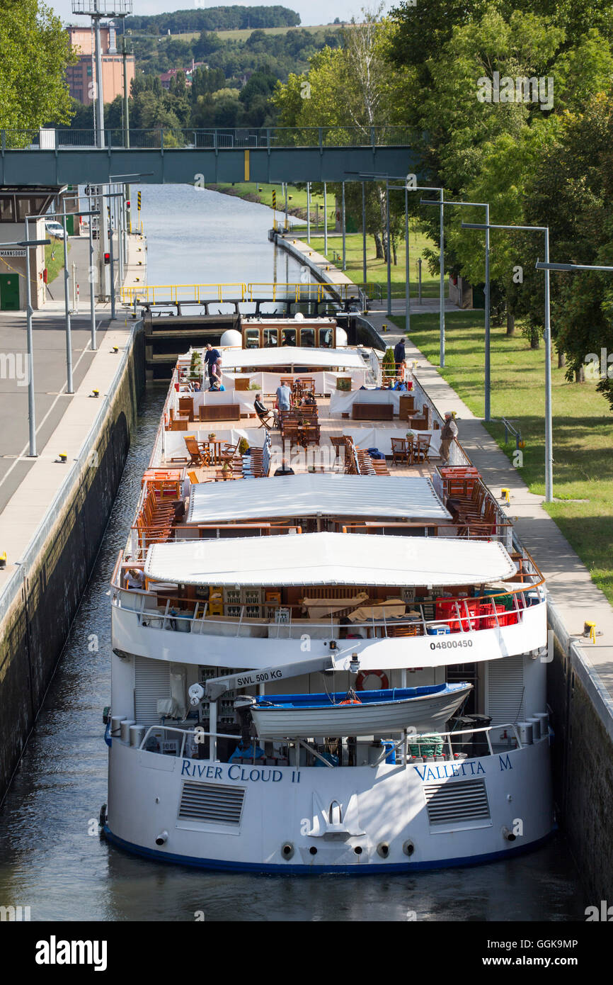 River cruise ship River Cloud II in a lock on the Main river, Ochsenfurt, Franconia, Bavaria, Germany Stock Photo