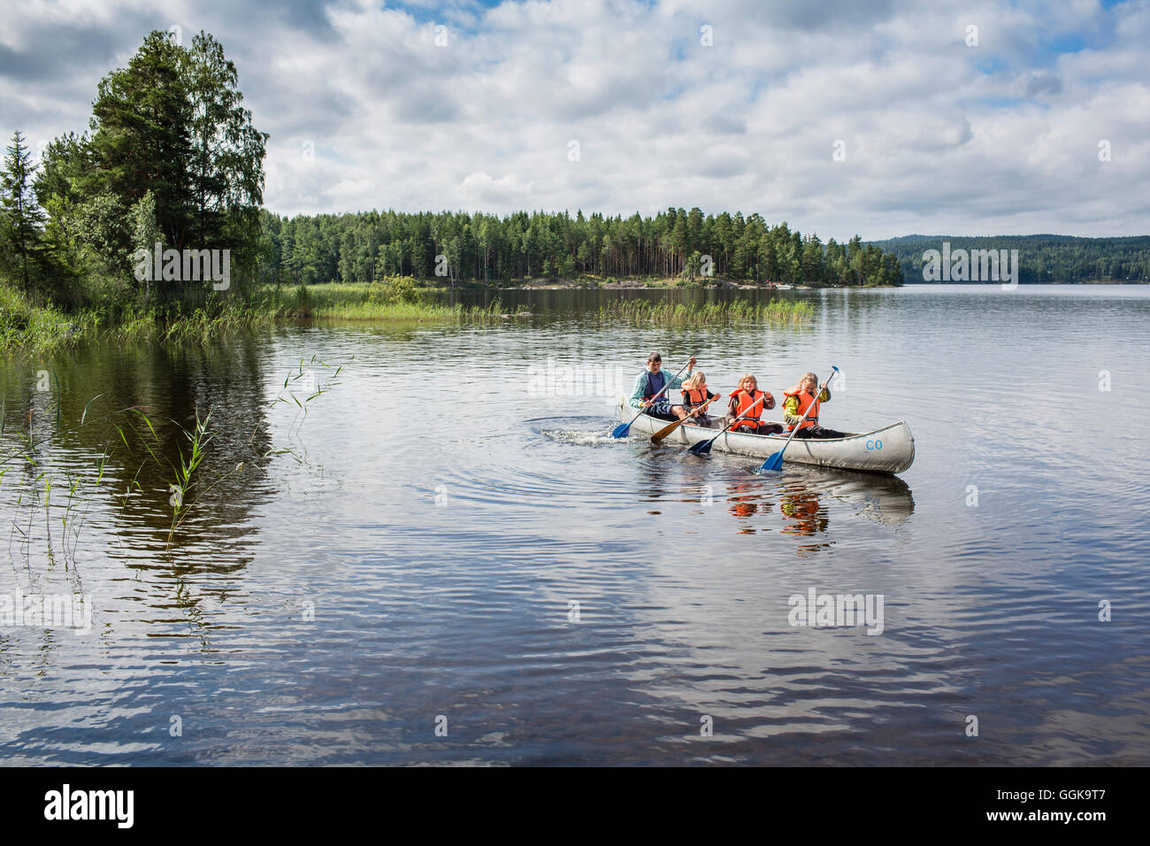 Children in a canoe on lake Vaermeln, Vaermland, Sweden - Stock Image