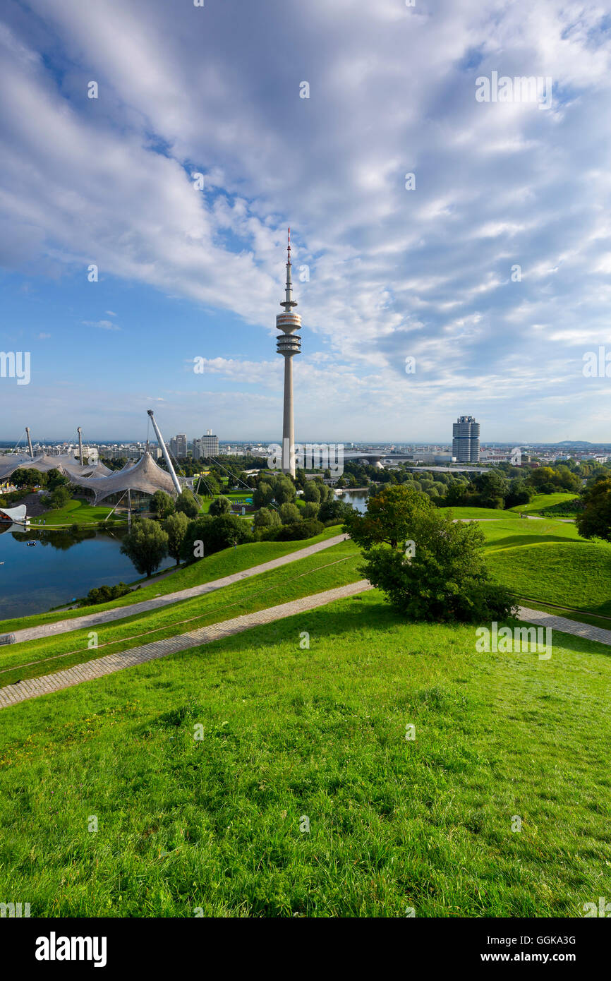 View from Olympic hill to the Olympic tower and the BMW tower, Allianz Arena in the background, Munich, Upper Bavaria, - Stock Image