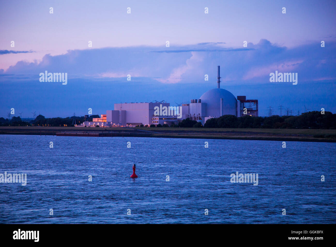Elbe river and Stade Nuclear Power Plant at dusk, Stade, Lower Saxony, Germany - Stock Image