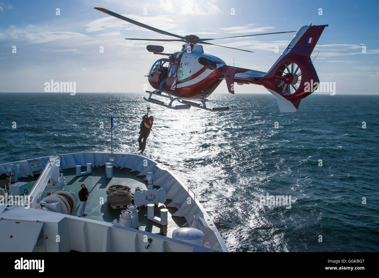 Helicopter airlifting Dunkerque pilot from the bow of cruise ship MS Deutschland (Reederei Peter Deilmann), North - Stock Image