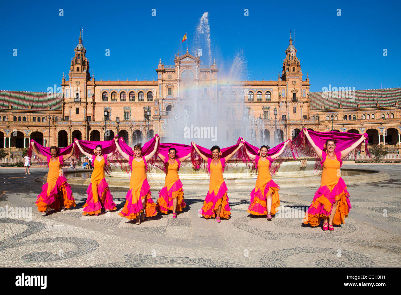 Flamenco Fuego dance group on Plaza de Espana in front of the fountain, Seville, Andalusia, Spain - Stock Image