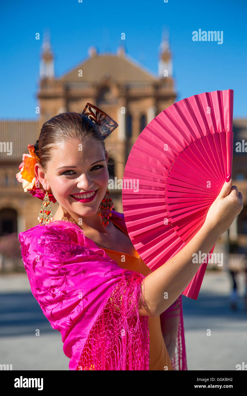 Young woman from Flamenco Fuego dance group on Plaza de Espana (MR), Seville, Andalusia, Spain - Stock Image