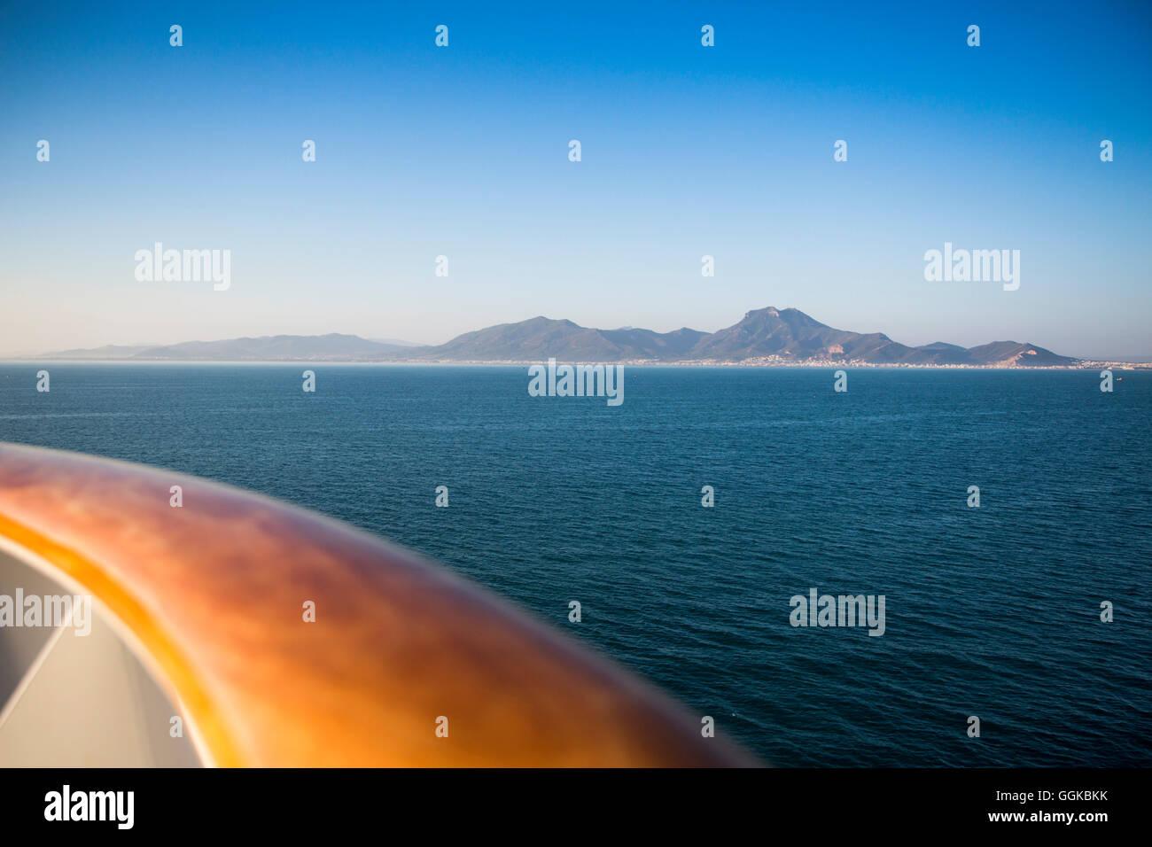 Railing of cruise ship MS Deutschland (Reederei Peter Deilmann) and Tunisian coastline, near La Goulette, Tunis, - Stock Image