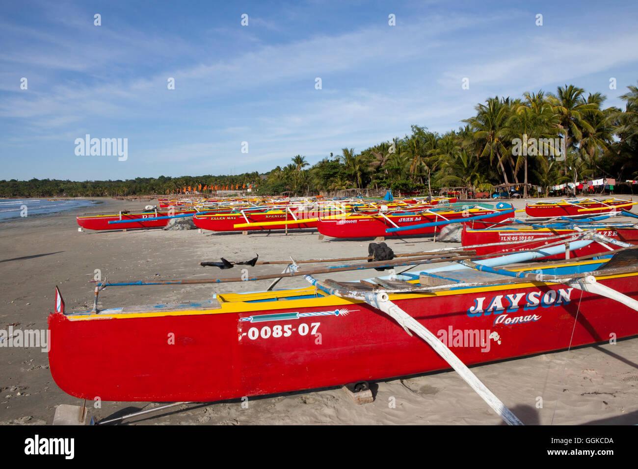 Fishing boats at Pug-Os Beach near Laoag City, Ilocos Norte province on the main island Luzon, Philippines, Asia - Stock Image