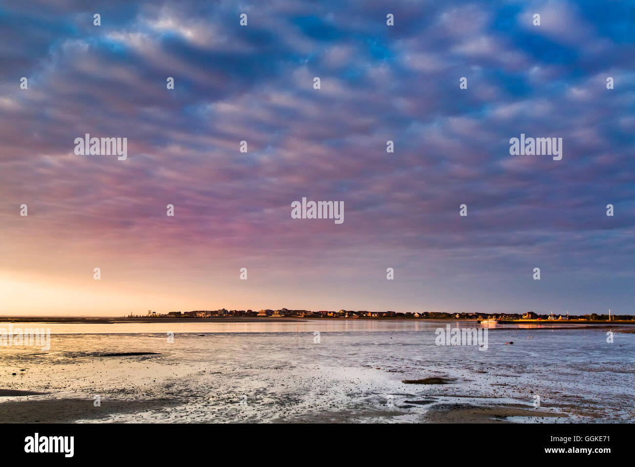 Sunrise over the wadden sea, Amrum Island, North Frisian Islands, Schleswig-Holstein, Germany - Stock Image