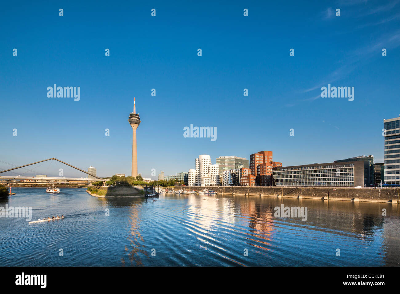 Frank Gehry buildings and television tower, Neuer Zollhof, Media harbour, Duesseldorf, North Rhine Westphalia, Germany - Stock Image