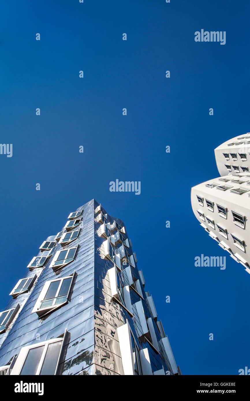 Frank Gehry buildings, Neuer Zollhof, Media harbour, Duesseldorf, North Rhine Westphalia, Germany - Stock Image