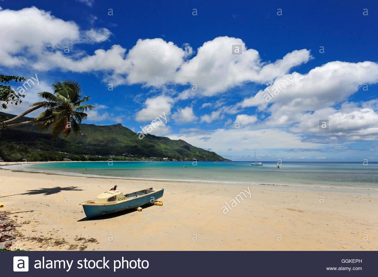 Boat on the beach, Beau Vallon, Mahe Island, the Seychelles, Indian Ocean - Stock Image