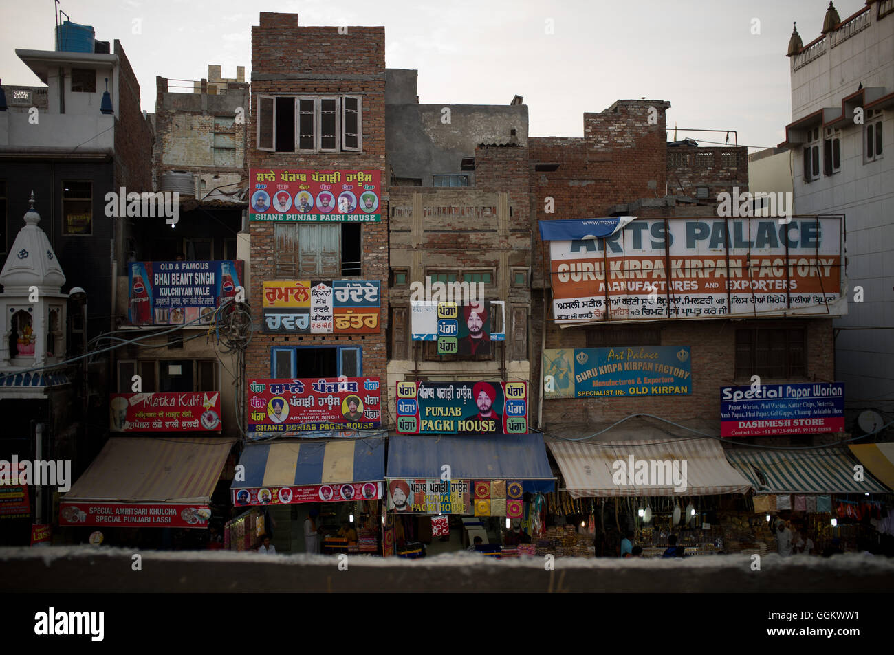 Ads on the facade of buildings in Amritsar, India. © Jordi Boixareu - Stock Image