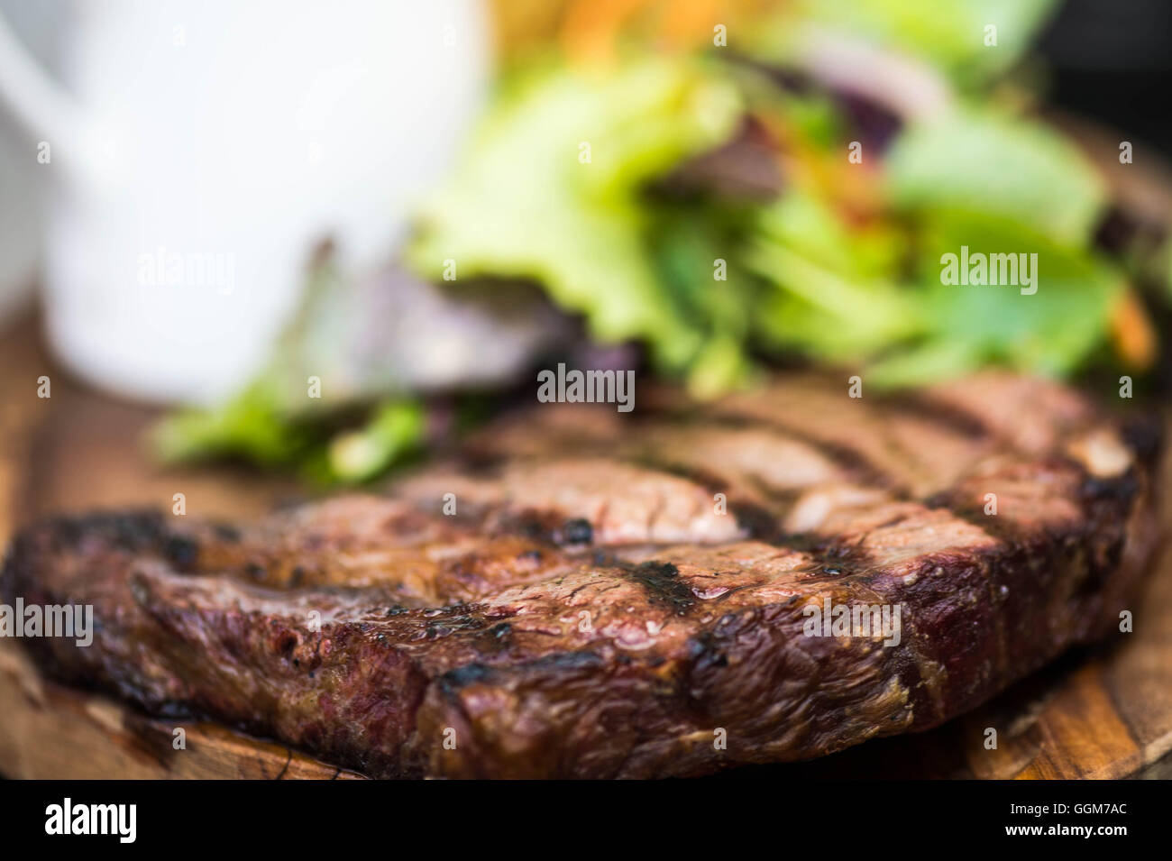 Succulent Grilled Fresh Fillet Of Ribeye Beef Steak Served With A Green Leaf Salad With No People Stock Photo