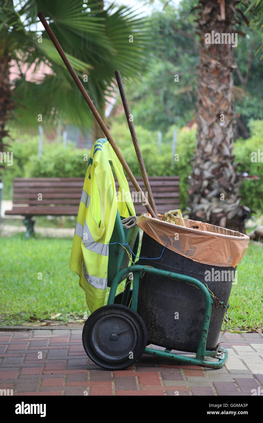 Mobile Waste Can. Mobile Waste Can, Mobile Garbage Can, Mobile Trash Can of a street cleaner with orange garbage - Stock Image