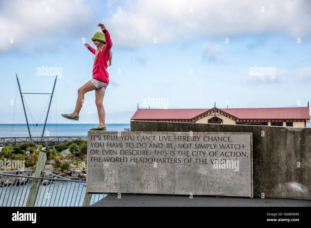 A girl balancing, Wellington, North Island, New Zealand - Stock Image
