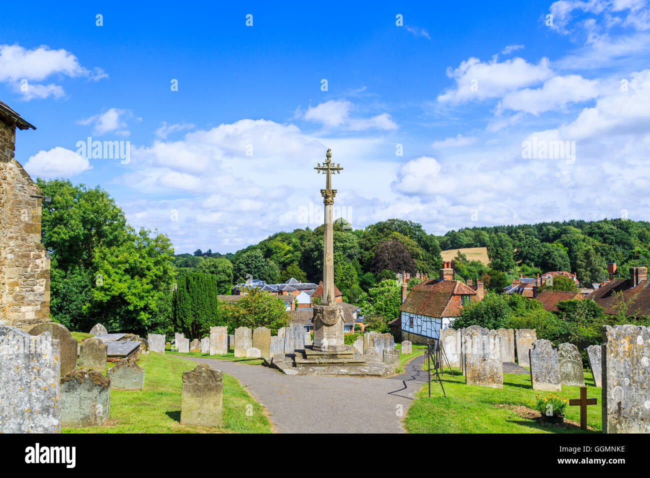 War memorial and churchyard at St Mary's Church, Westerham, a town in the Sevenoaks District, Kent, in summer - Stock Image