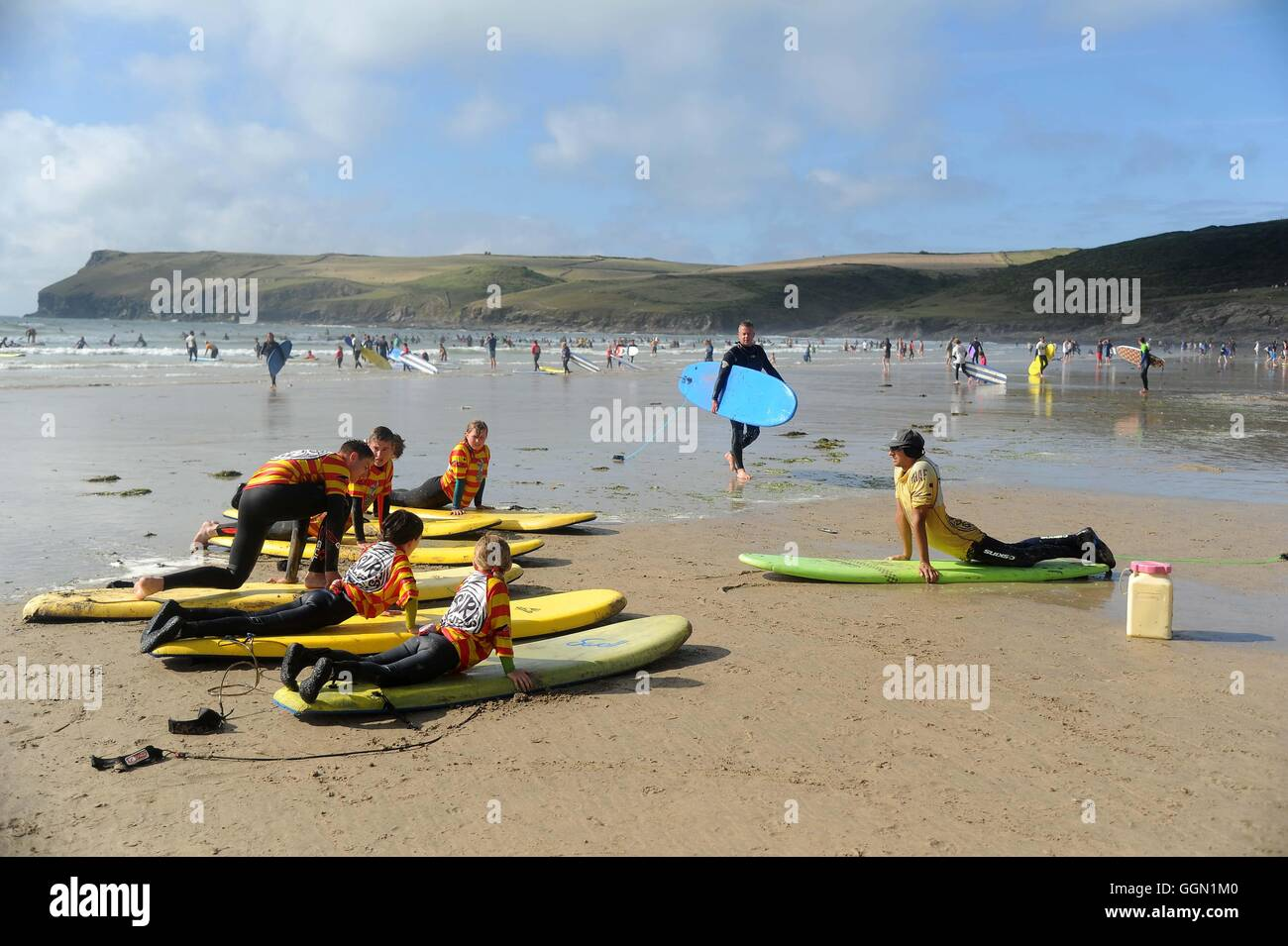 Surfing lesson at Polzeath beach, Cornwall, UK - Stock Image