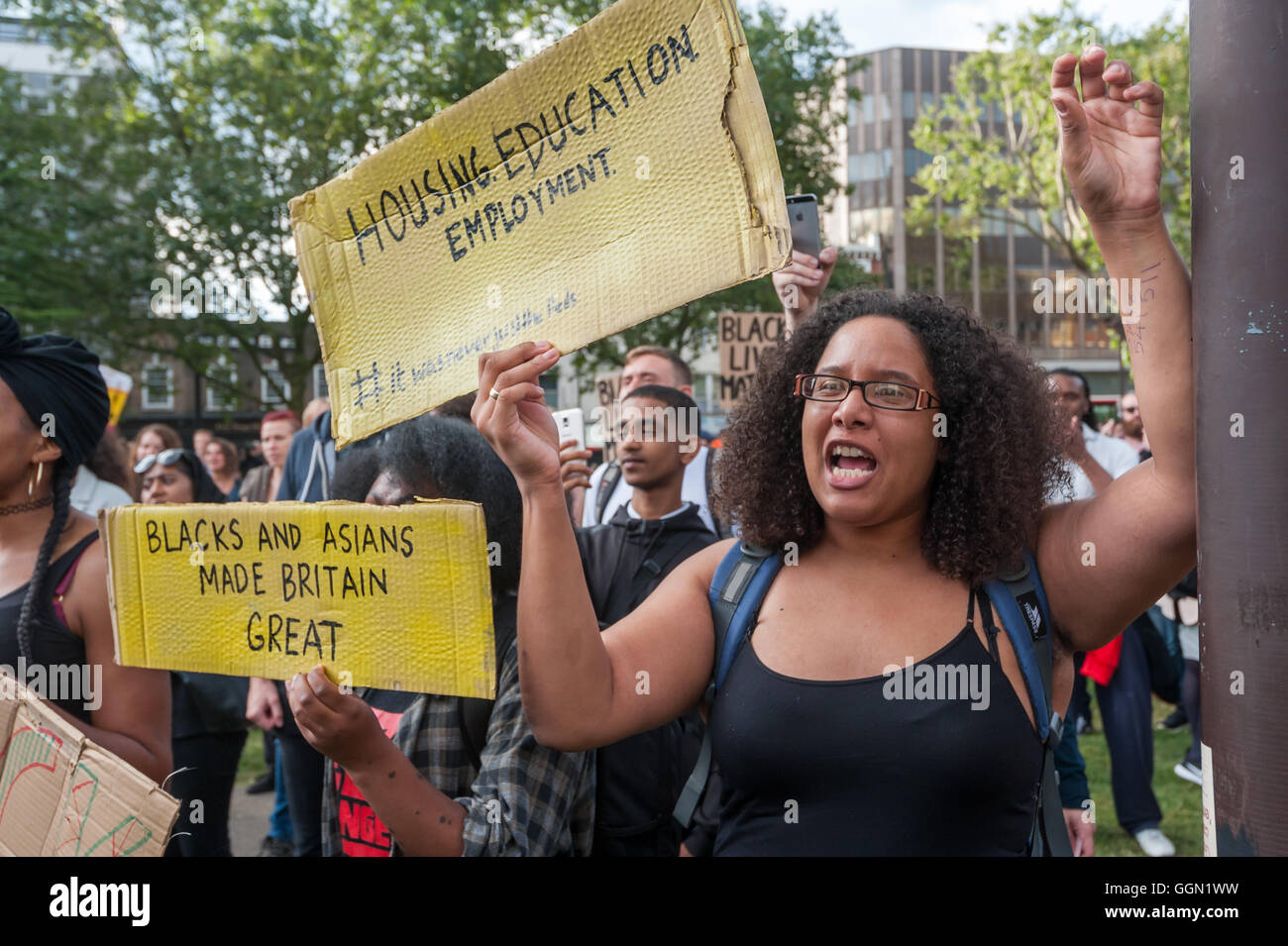 London, UK. 5th Aug, 2016. A woman holds a poster'Housing, Education, Employment' at the rally five years - Stock Image